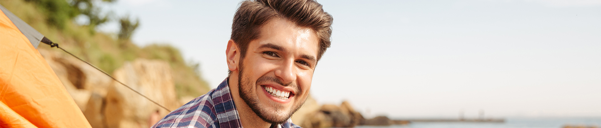 Younger man smiling